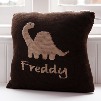 personalised knitted dinosaur cushion