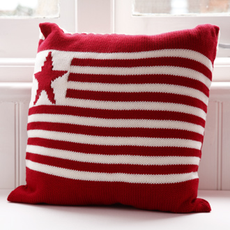 bespoke merino wool knitted star and stripes cushions