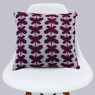bespoke merino wool knitted butterfly print cushion