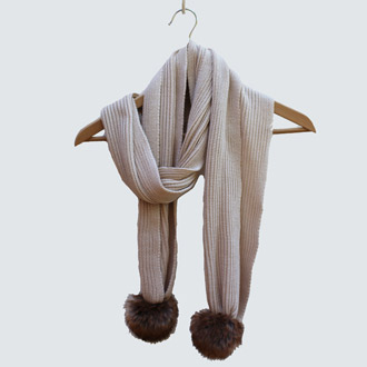 ladies merino wool knitted scarf with faux fur pompoms