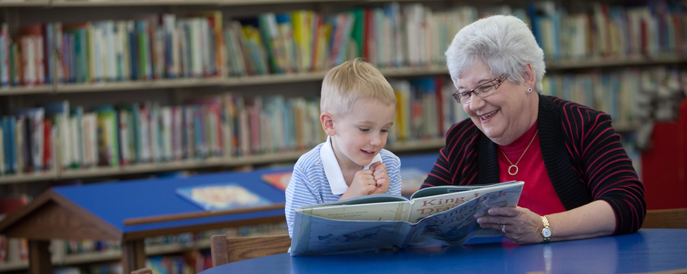 Lynne Walters reads a book to her grandson North at the Morton Public Library
