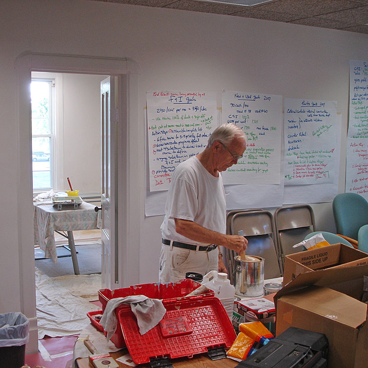 Harold Witzig helping paint the first MCF Office at 309 N Main, Suite B.