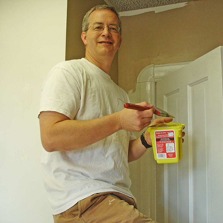 Scott Witzig helping paint the first MCF Office at 309 N Main, Suite B.