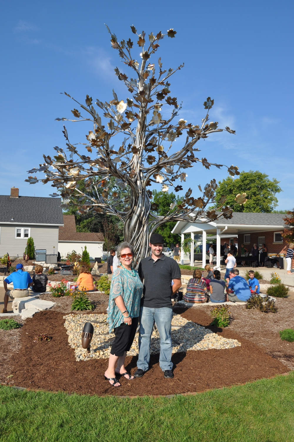 Giving Tree sculptor, Morgan Elser, and her lead fabricator, who is also Morgan's nephew, Steven Fosdyck