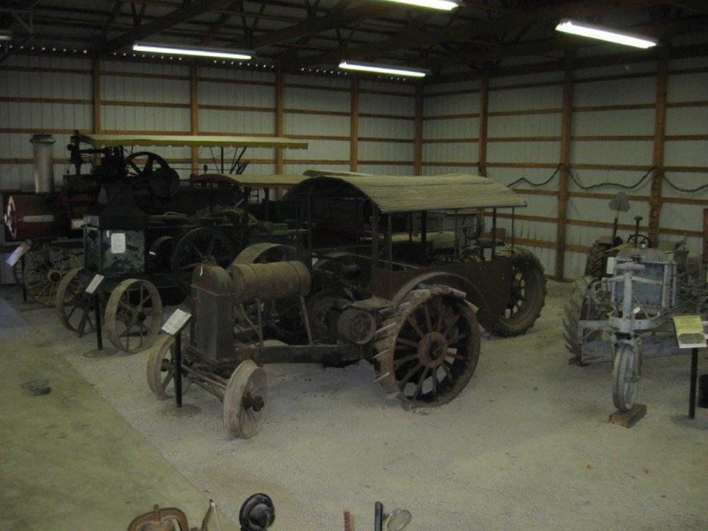 Early tractors and steam engine.jpg