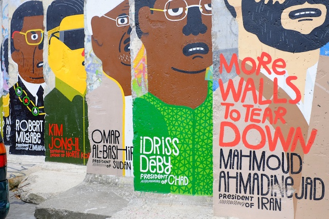 More walls to tear down: Dictatorships that survive, graphically illustrated on sections of the old Berlin Wall on Zimmerstrasse at Checkpoint Charlie. (Photo: Mike Evans)