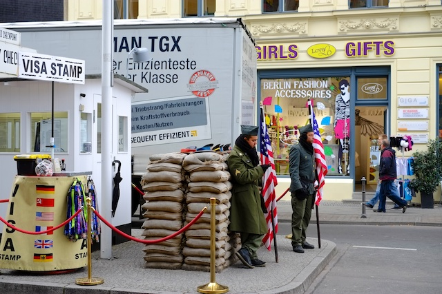 Business as usual at Checkpoint Charlie: Actors dressed as American soldiers, tourist tat at what was once the first sight of freedom for emerging East German citizens. (Photo: Mike Evans)