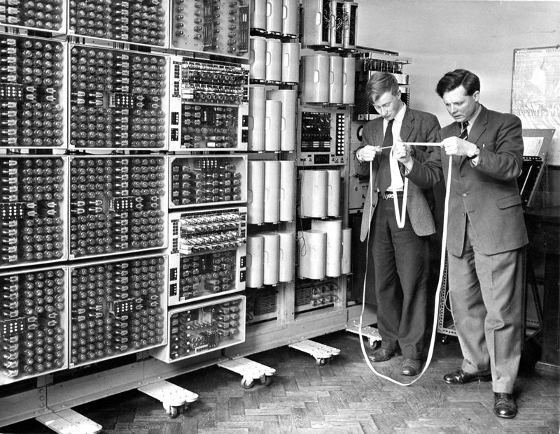 Imagine if today's texteens had to read punch tape. At least they are still wearing the same baggy pants. Photo courtesy of Wolverhampton Express & Star, via National Museum of Computing