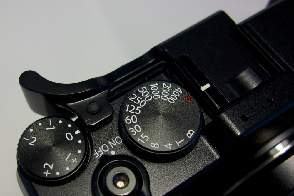 Thumbs Up: Tim Isaac's latest in the line of Thumbs Up grips is specially designed for the X-E1 and slides firmly into the hotshoe. Note the indentation on the top of the lug which serves as a reference point for the exposure dial (the standard white line is covered by the lug).