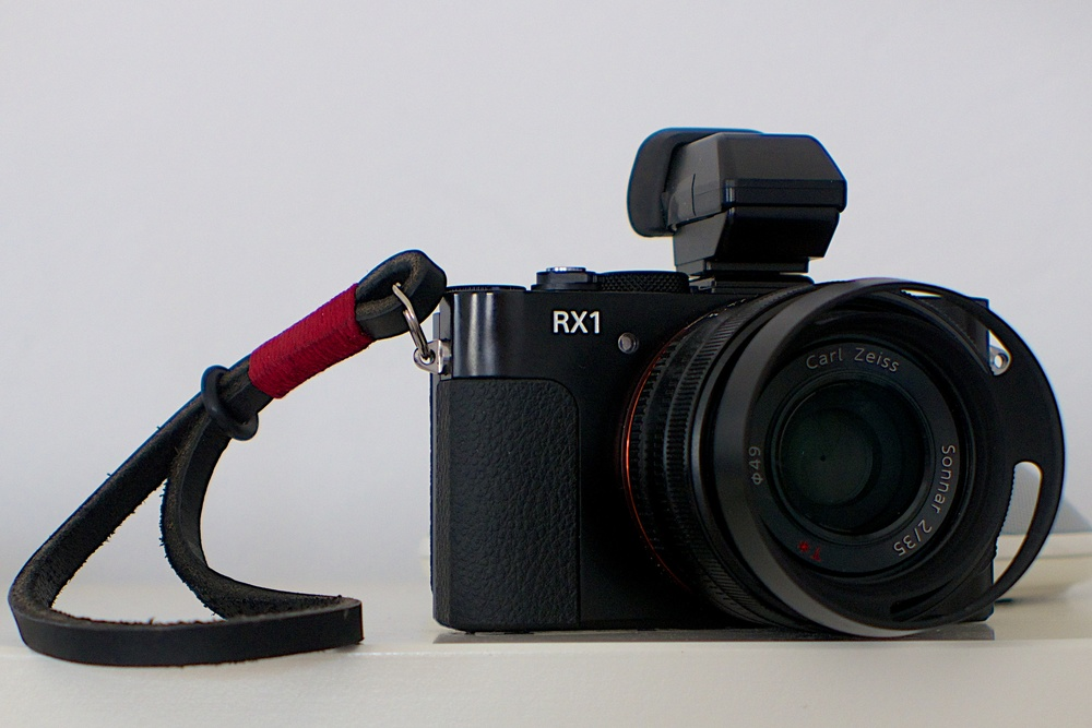 My bargain second-hand Sony RX100 with Gordy leather wrist strap (small), £5 Amazon lens hood and Sony's excellent 2.4 MP electronic viewfinder. I am working on my review and hope to publish next week.