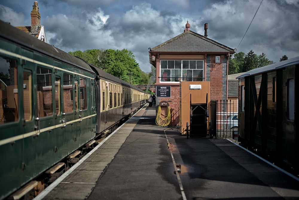 Storm clouds gather over Bishops Lydeard station at the southernmost end of the West Somerset Railway. Norton Manor steaming at the head of the train