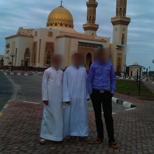 Hafid (right) and his friends photographed on the stolen smartphone