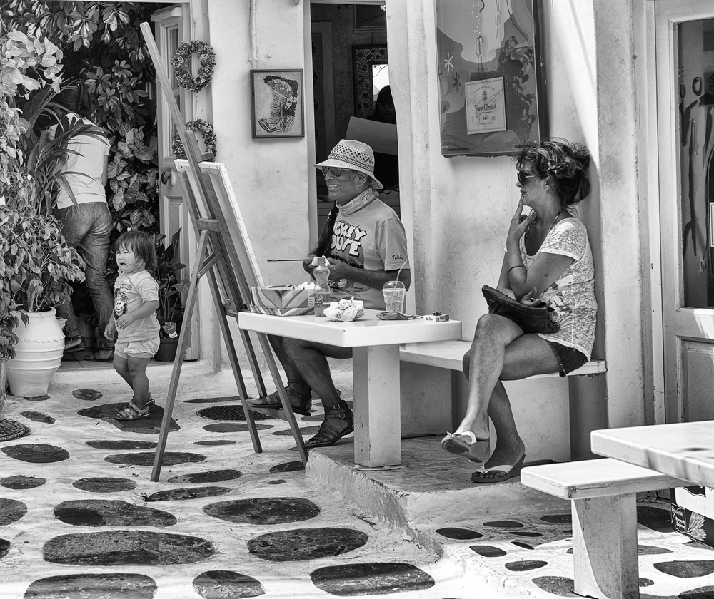 Three happy, one unhappy - Mykonos street scene. 75mm APO Summicron, 1/750s at f/9.5, ISO 320 (Photo Mike Evans)