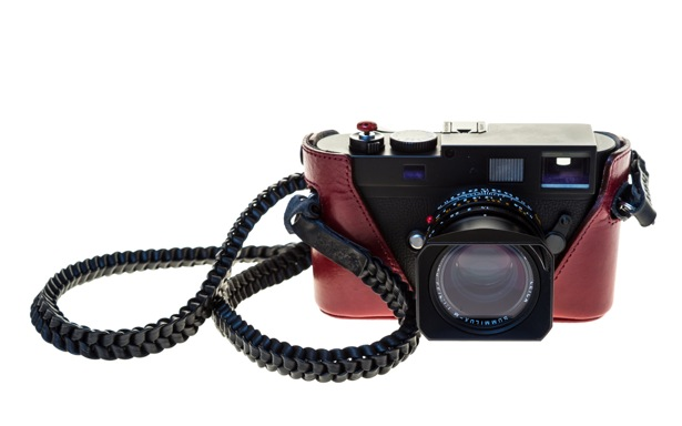 Leica Monochrom with Artisan & Artist red-leather half case, Braidy strap, Match Technical shutter release bug and 35mm Summilux FLE lens. I suppose the red rather takes away the stealth aspect of the MM, but it does look good.
