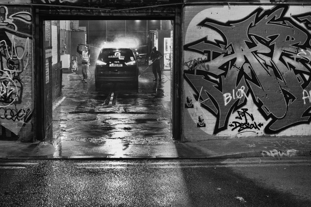 ISO 4,000, f/1.4 at 1/360. This is an interesting comparison between the low-lit graffiti wall and the more brightly lit interior of the car wash. Note the impressive detail inside