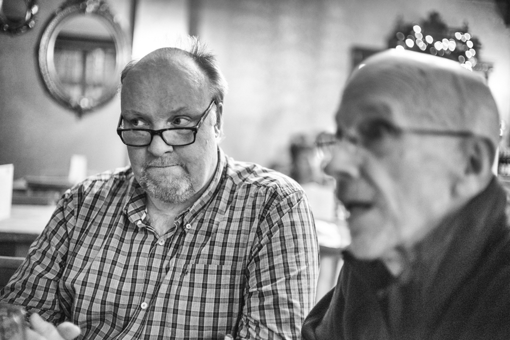 John Cartwright in pensive mood with George James contributing some uncharacteristically wobbly foreground bokeh during the pub lunch (Photo Mike Evans)
