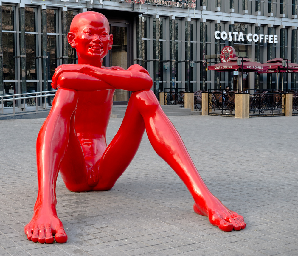 "Far East meets Britain's Costa Coffee in Sanlitun, Beijing. This is one of the famous ""Red Memory"" sculptures by artist Chen Wenling"