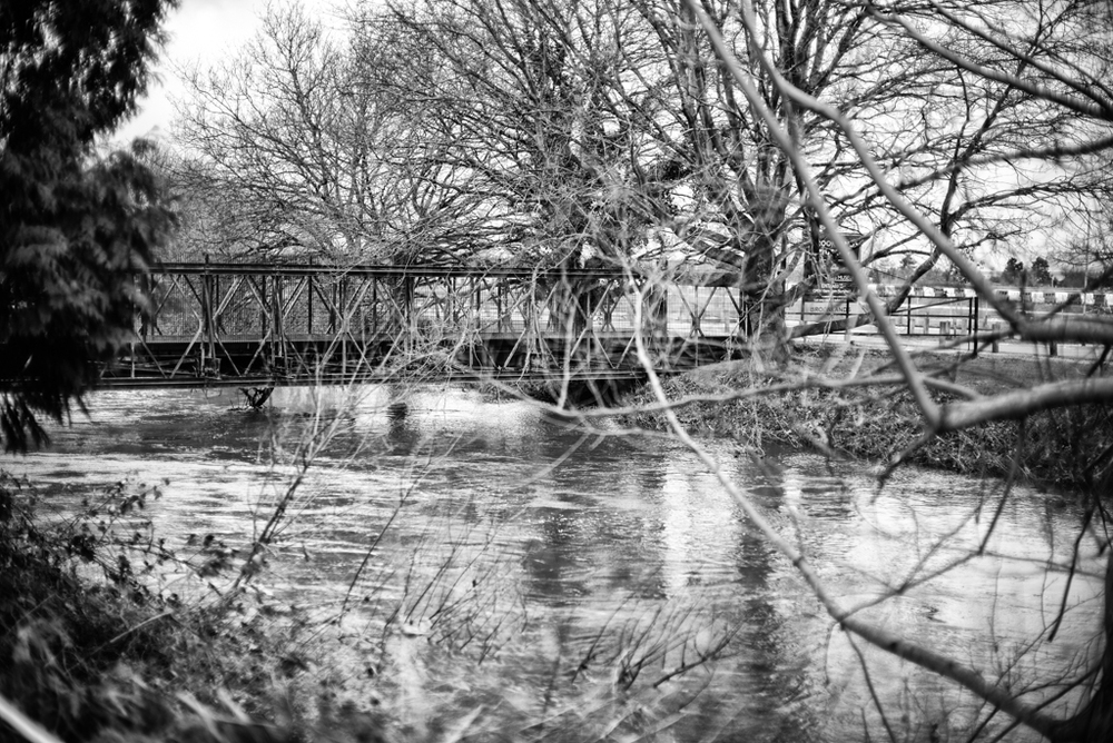 The River Wey is ready to burst its banks as it flows past the Brooklands Museum. Leica M, Noctilux at f/0.95 and ISO 200