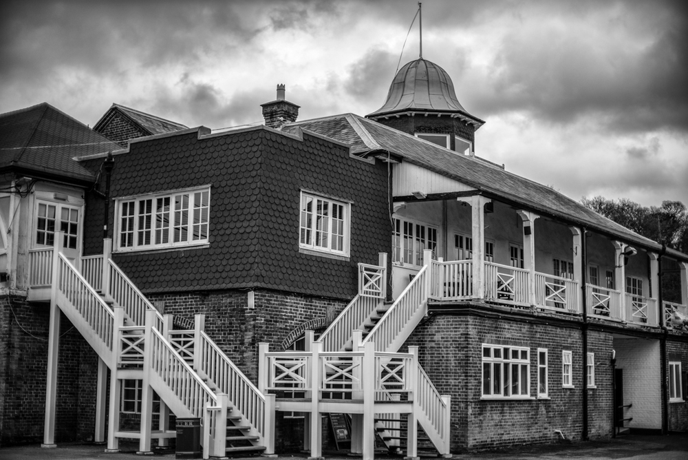 Storm clouds gather over the ancient club house at Brooklands. Leica M and 0.95 Noctilux at f/4