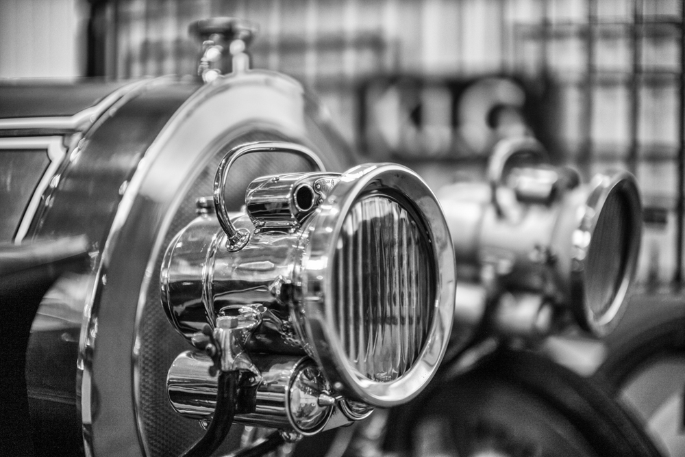Chitty Chitty Bang Bang's headlight in focus at Brooklands. Note how critical focus can be with the 0.95 Noctilux wide open. This shot is at ISO 1000 with focus on the centre of the lamp body.