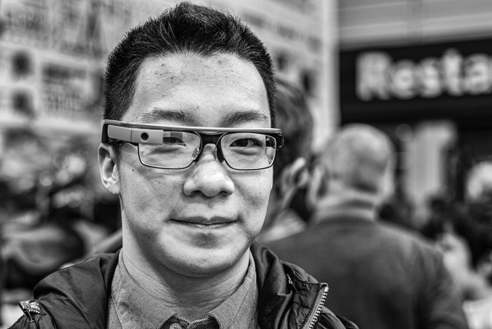 Google Glass: My first sighting in the wild and at a photographic exhibition of all places. He was trying to look inconspicuous but I spotted the Glass at fifty paces (Leica M, 35mm Summilux, (ISO 400)