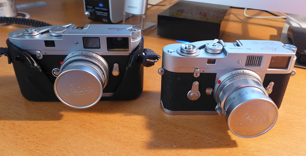 Herr Schmidt's carefully tested M2 (right) gets acquainted with Hercule Poirot's Leica MP, a camera that was made 45 years later but is essentially a very similar device, add a light meter and a few tweaks.