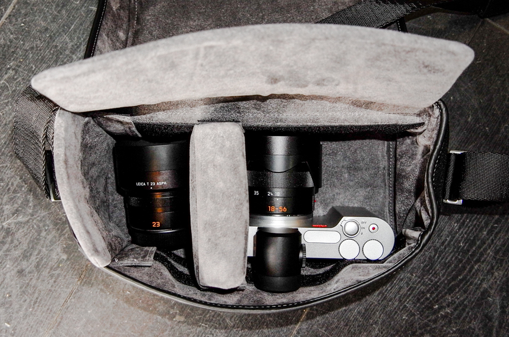 The medium system bag easily houses an M with lens and EVF with space for one or two additional lenses. Here it is shown with the Leica T and 18-56 Vario-Elmar-T plus the 23mm Summicron-T, both lenses with hoods. There are two dividers (one is shown to the far left) to create up to three compartments