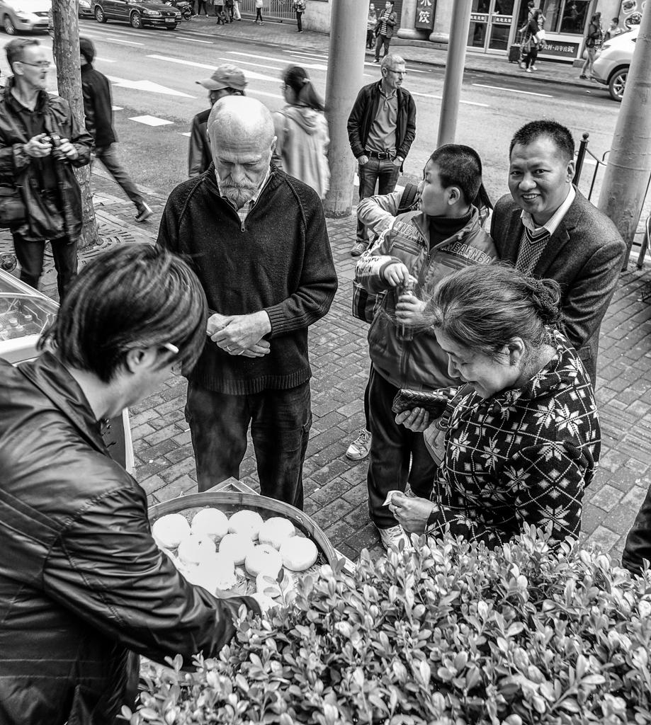 孔老夫子, Old Confucius, who also answers toBrad, buys a bag of ¥1 buns (black and white conversion by Mike Evans)