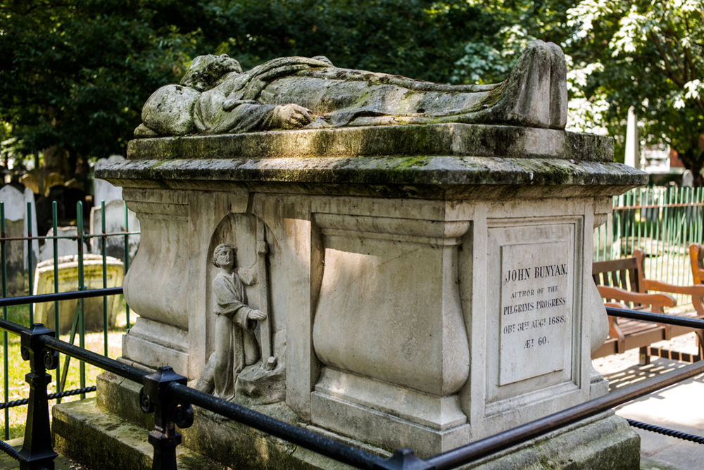 The tomb of John Bunyan, author of The Pilgrim's Progress, is prominent in Bunhill Fields