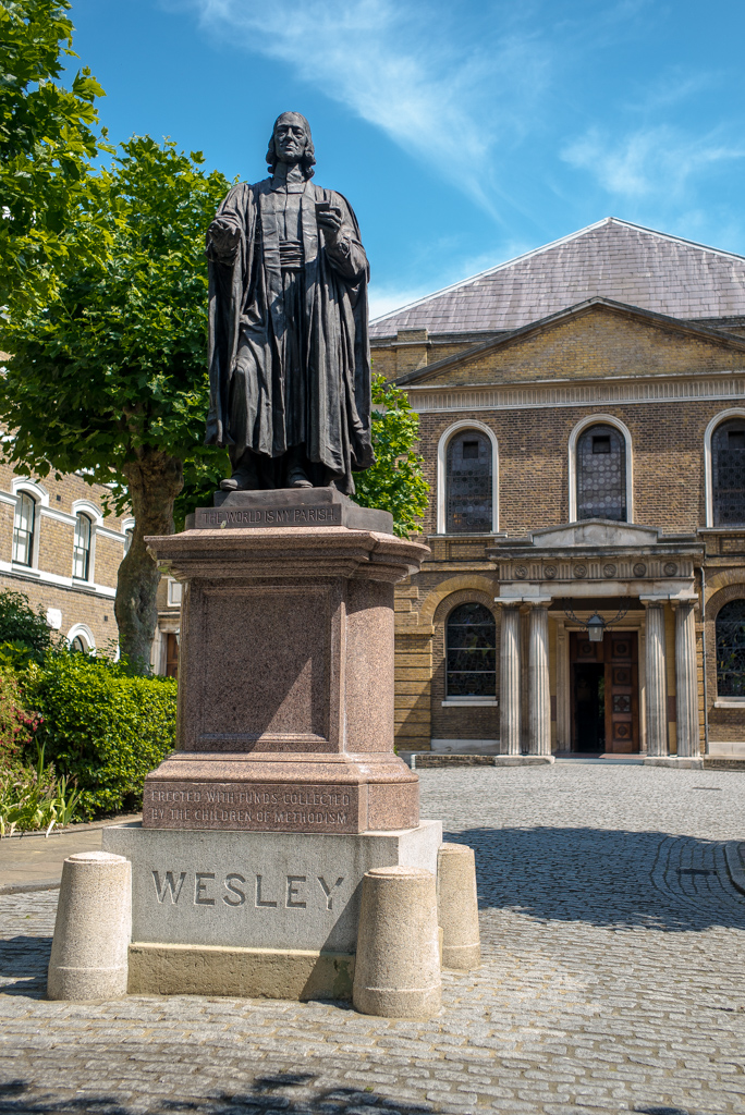 The founder of Methodism, John Wesley. In the background, Wesley's Chapel