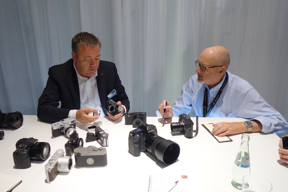 Leica's holy of holies, groaning with toys: Stefan Daniel explains the new cameras to Mike Evans (photo by Dr. Michael Pritchard, Royal Photographic Society)
