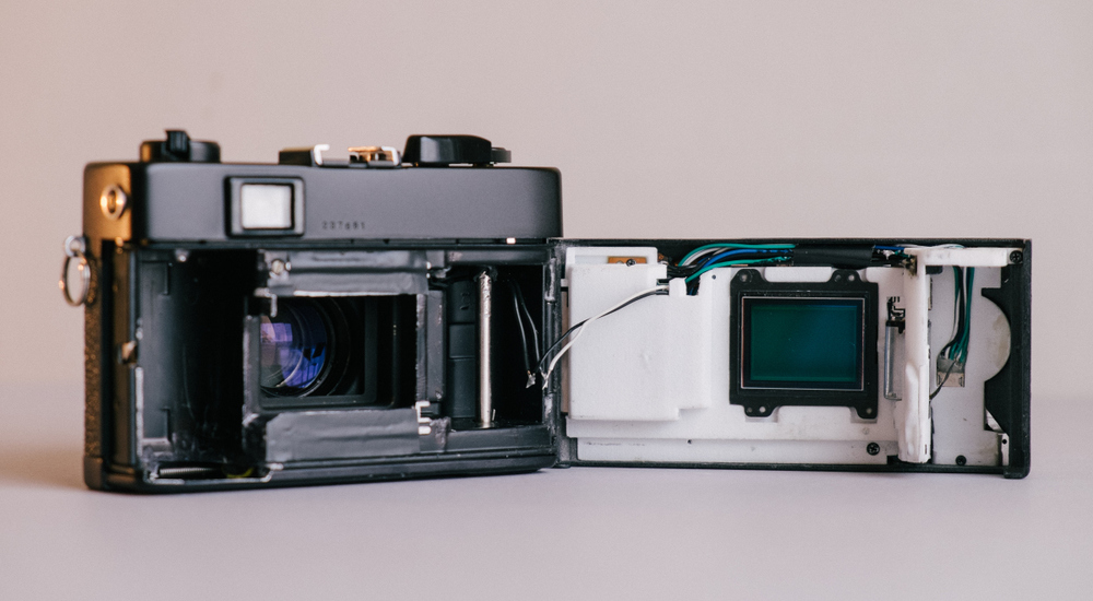 Inside the Konica showing the 3D-printed  housing for the electronics with the sensor mounted on the front