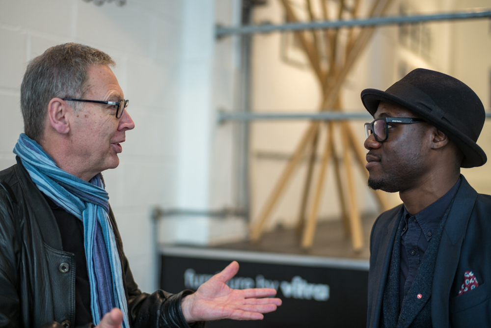 German visitor Wolf Ehrenberg, a lifelong Leica addict and the son of a former Leitz employee, discusses his photography with Leica's Arteh Odjidja who currently runs the Leica store in the Burlington Arcade and has been helping out with the Brick Lane pop-up event