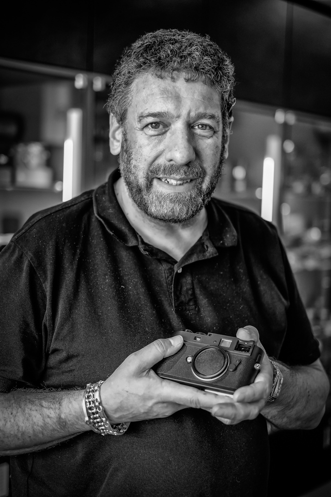 Ivor Cooper of Red Dot Cameras handing back my cherished Leica Monochrom