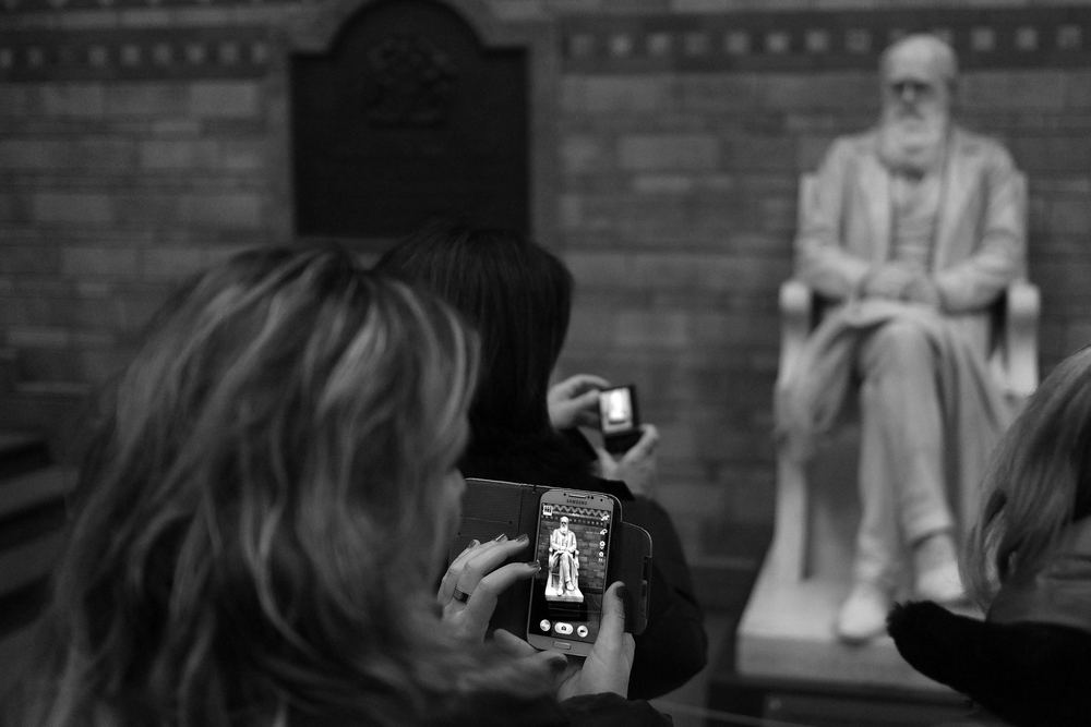 Charles Darwin meets the smartphone at the Natural History Museum. Photo by Bill Palmer using the Fuji X-Pro 1 and 23mm Fujinon.