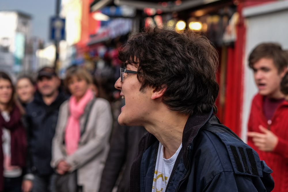 Autofocus, as demonstrated here with the Fujinon 56mm (shot wide open at f/1.2), has speed advantages for impromptu street photography. Face detection worked extremely well in this crowded Portobello Road street market