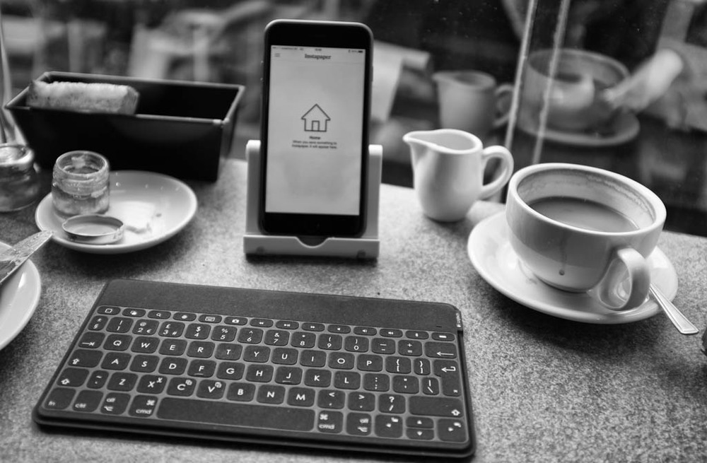 Logitech's new Keys to Go keyboard is water and dust proof, immune to cappuccino and croissants, and is large enough to provide a near full-size keyboard experience with a high degree of accuracy (Photo: Fuji X100T). You need to provide your own iPhone or iPad stand, as here with my cheap plastic stand (linked below)