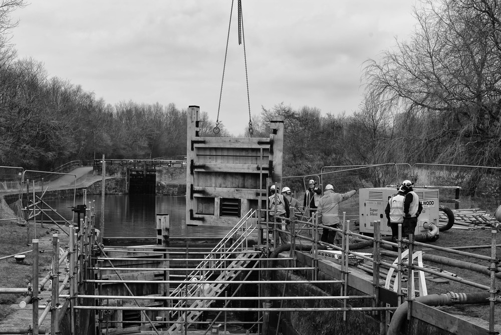 Lock gates, identical to the original 200-year-old constructions, are lowered into place