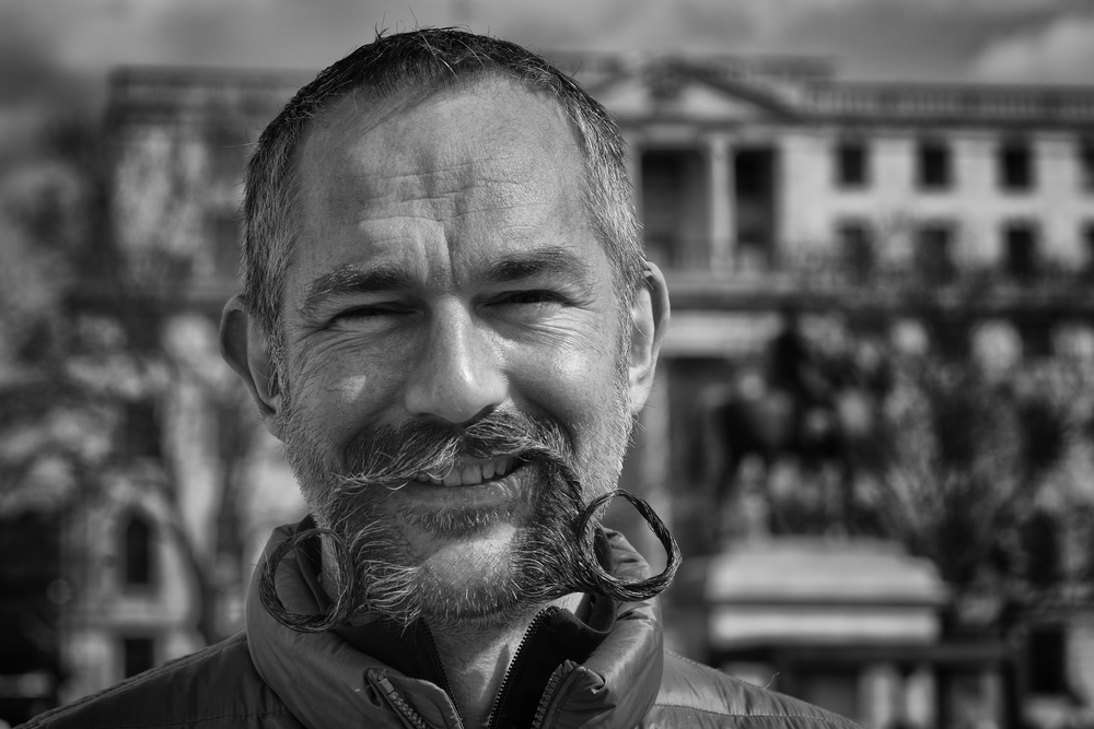 75mm or even 90mm lenses are not too subject-remote as to be impersonal. You are still close enough to have a chat and ask permission, as I did with this splendid moustachioed gent in Trafalgar Square on Easter Sunday. This is taken with my wonderful 75mm Leica Apo-Summicron perched on a Sony a7II body (at f/8)