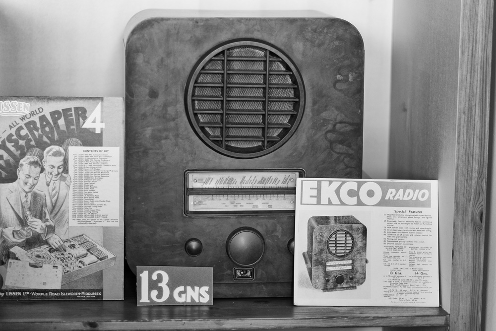 An expensive purchase: This radio at £13. 13s. 0d (£13.65) would have been well beyond the means of all but the richest inhabitants of the village in the 1930s. Below, a crop from this Ricoh GR shot explaining the wondrous delights of the Ekco, available on easy payments of £1. 5s (£1.25) a over twelve months. Copywriters in the 1930s were just as ingenious as they are now. I never knew I wanted a detachable fret. However, since there were only two programmes, the Light and the Home, that fancy station scale was possibly overkill unless you wanted to tune in to foreign wavelengths