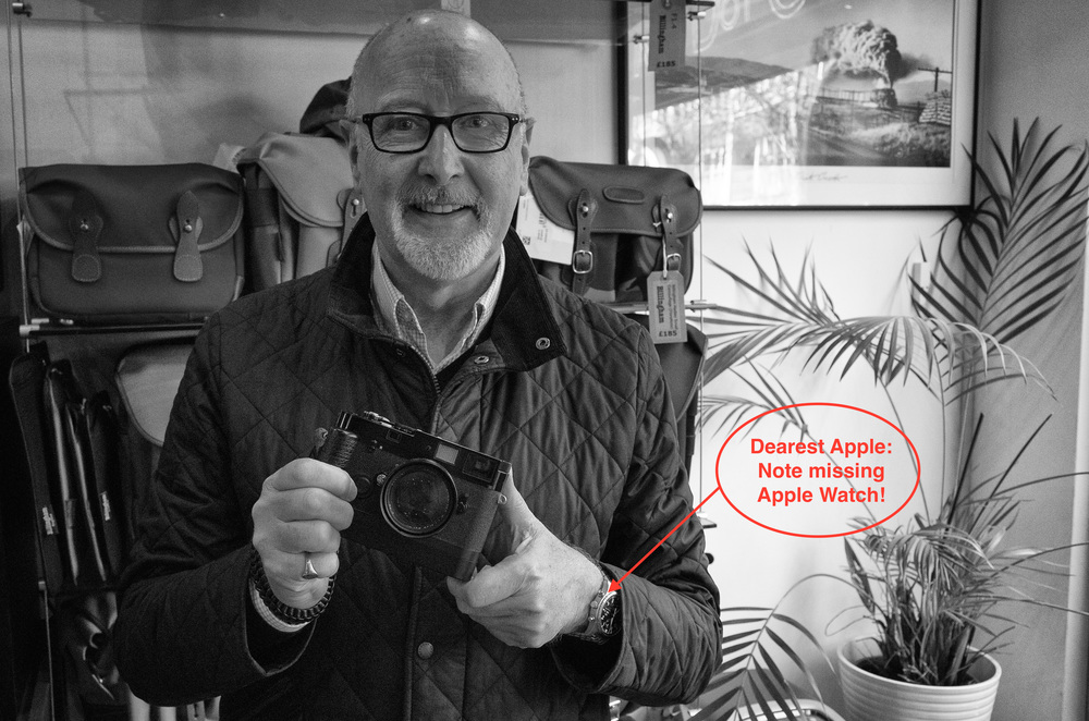 The author with thenew, second-hand Leica Motor M attached to his2004 Leica MP.Photographed at Red Dot Cameras in London