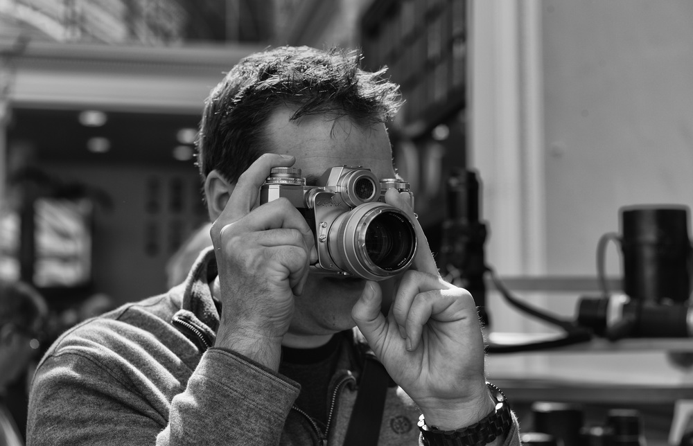 David Lewis tries out a Contax Bullseye. Last year I caught him with the purple-shrouded M3 that he had bought and customised as a surprise engagement present