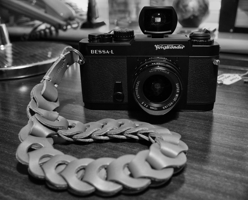 This Bessa-L is virtually as new, apart from the dust obvious in the photographs below. Although probably 15 years old, it looks modern and purposeful. Love at first sight. See the Tie Her Up camera wrist strap designed by  Evris Papanikolas