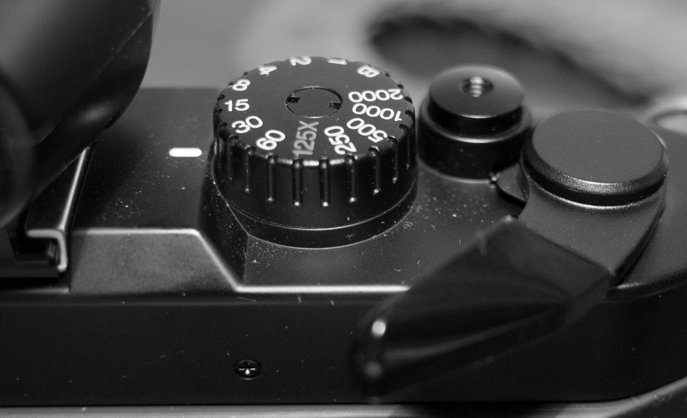 The film-advance lever must be pulled away from the camera body to switch on the electronics and allow the camera to fire