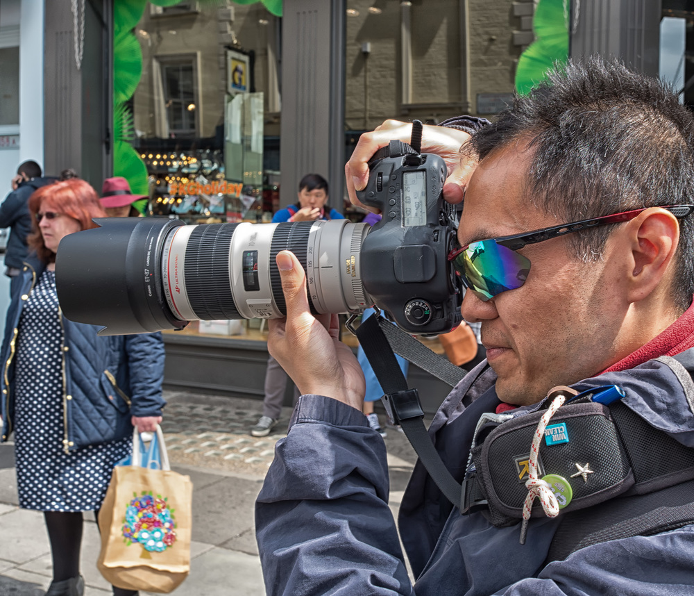 "f/8 at 1/100s, ISO100 - the alternative street photographer whose valour is the better part of his discretion: ""Big lens? No, not really. It's the hood."" Is it any wonder that savvy street photographers use a camera such as the Leica X and prefer to get up close to their subjects?"