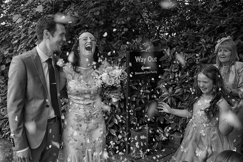 No way out, the knot is tied. Leica Q doesn't much care for confetti in its hood