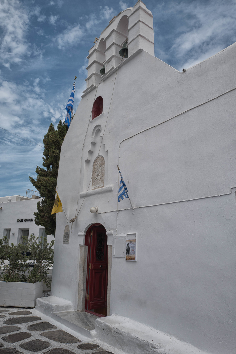St. George's church, Mykonos Chora, a new perspective in a narrow street. Luis Vuitton in competition for the soul
