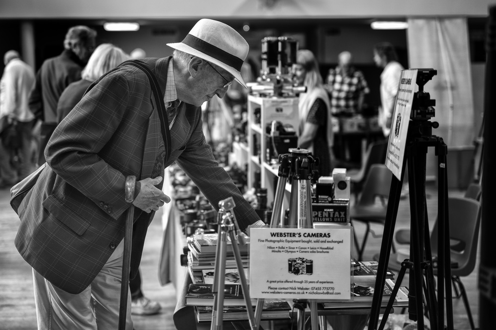 Camera fairs are very popular for the wide variety of, mostly, old cameras and equipment. There's always the possibility of a bargain but you need to be up early for the choicest worms. Here is the Webster's stall at the South London Camera Fair in Sidcup this morning. Taken at f/2.8, 1/125s,ISO 800 (click to enlarge)