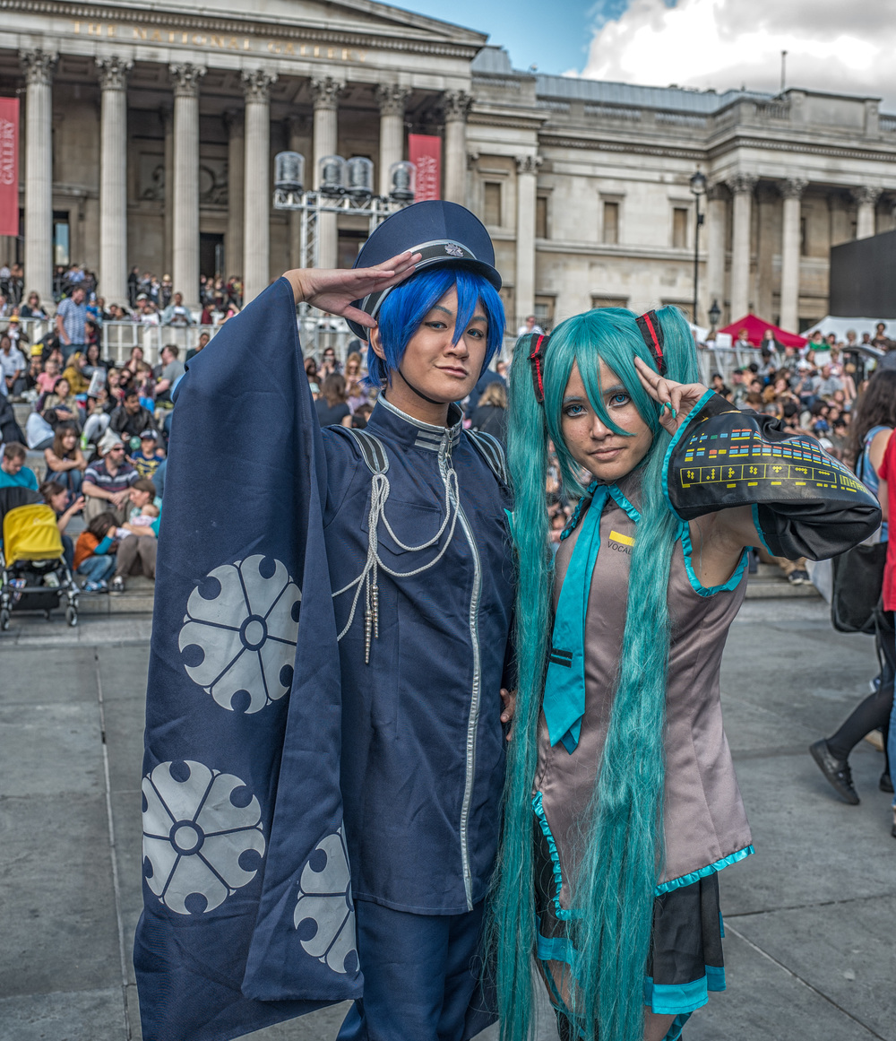 Kaito, Fairyking Cosplay, and Miku, Kisaki Cosplays, in martial mood