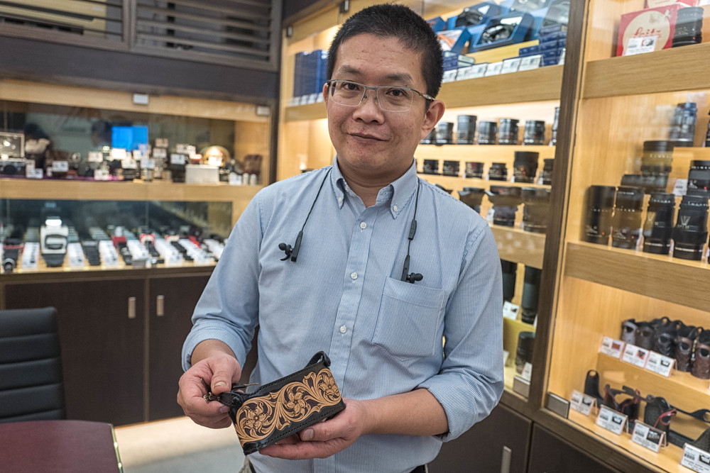 Frankie Lee at M&K Cameras demonstrates one of his tooled-leather Leica cases. Who needs cowboy boots?